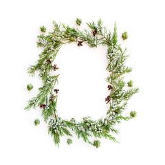 Christmas round frame made of evergreens and cones