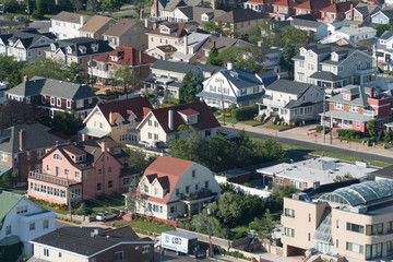 Aerial view of luxury shoreline seaside homes. Expensive houses built on water front for summer community living