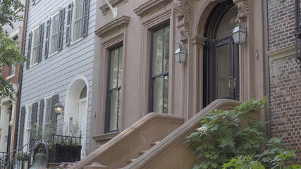 Exterior establishing day photo shot of typical Brooklyn style brownstone facade.