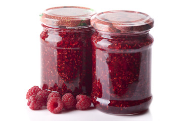 Two jars with raspberry jam    on a white background
