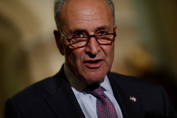 Senate Minority Leader Chuck Schumer speaks with reporters following the party luncheons on Capitol Hill in Washington
