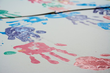 Hand make a trace colorful symbol on white paper background