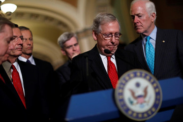 Senate Majority Leader Mitch McConnell speaks with reporters following the party luncheons on Capitol Hill in Washington