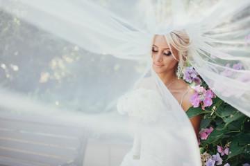 Printed kitchen splashbacks Artist KB Beautiful bride with wedding hairstyle. Closeup portrait of young bride. Wedding. Beautiful bride portrait with veil over her face. Beautiful bride in veil on the wedding day