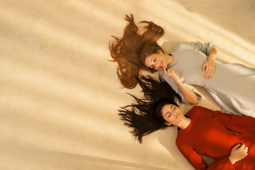 High angle view of young women lying down on their back