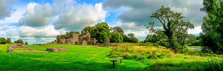 Landscape of Inch Abbey in Northern Ireland. Monastery ruins in Downpatrick. Co. Down. Travel by car in summer. Fototapete