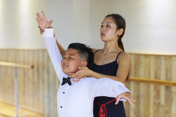 young asian dancing teacher teach her student dance indoor