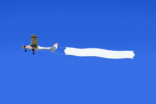 Reklama lotnicza, samolot ciągnie transparent.
