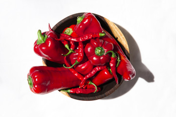 Variety of red peppers in a wooden bowl