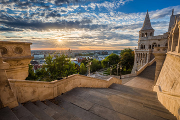 Budapest, Hungary - Staircase of the famous Fisherman Bastion on a beautiful sunny morning with sunrays and nice cloudy sky
