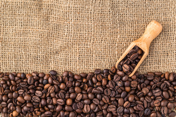 Mixture of different kinds of coffee beans with ladle. Coffee background