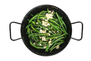 Frying pan with delicious green beans and almond on white background