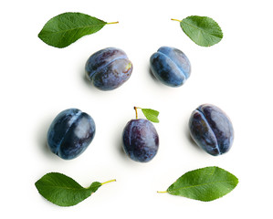 Composition with ripe plums on white background