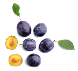 Fresh ripe plums on white background
