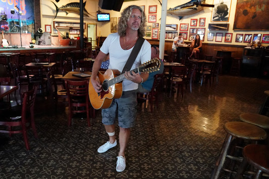 A musician performs in the eating area of a mostly empty Sloppy Joe's bar following Hurricane Irma in Key West, Florida