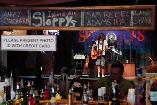 A musician performs in the mostly empty Sloppy Joe's bar following Hurricane Irma in Key West, Florida