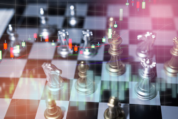 Chess board game concept of business competition and strategy with stock market graph background