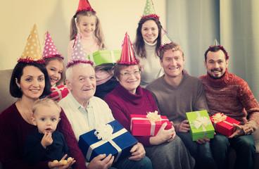Glad family making numerous photos