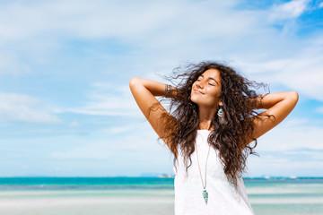 young cheerful woman having fun on the beach