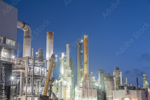 Oil refinery, oil factory, petrochemical plant at blue hour in