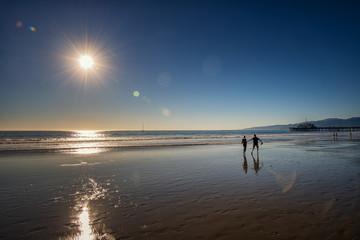 Couple on Santa Monica Beach at Sunset