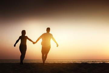Happy couple sea beach run