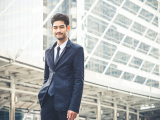 Portrait young asian businessman in modern city