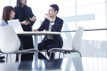 Business couple who is meeting with manager with three people