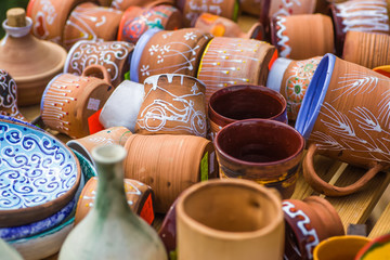 Ukrainian pottery. Pottery museum in Ukrainian village Oposhnya, center of Ukrainian pottery production. Different pottery products: bowls, pitchers, plates in museum.