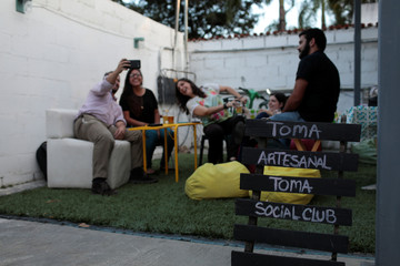 A sign is displayed in a beer garden at the garage of a brewery in Caracas