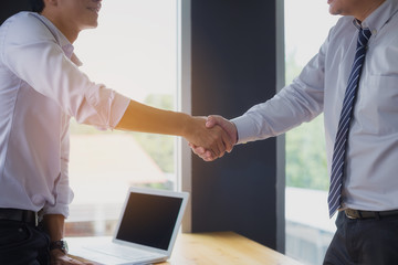 Close up image of hand of business people shaking hands after business negotiations