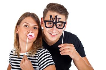 Happy couple posing in photobooth