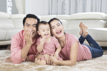 Cute baby having fun with her parents