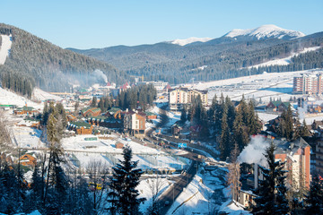 Beautiful view of a small town in the mountains on a winter day sun sunlight landscape nature living travelling morning daytime