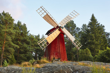 Foto op Canvas Molens Antique traditional wooden windmill in Finland. Picturesque finnish countryside