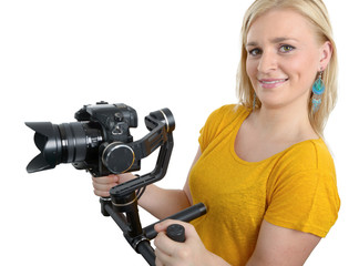 woman videographer using steady cam,