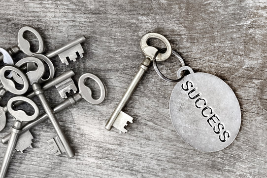key of success on wooden plank
