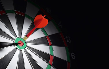 Dartboard with red dart arrow hitting the center. Marketing concept.