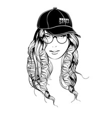 A girl in a baseball cap and glasses. Fashion girl.