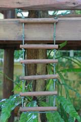 Rope wooden ladder.
