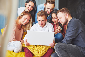 Group of creative young Friends Hanging Social Media Concept. People Together Discussing Creative Project During Work Process, play games or watch video film