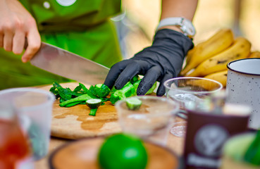 Cooking, Chef Cutting cucumber on hardboard and healthy food, Cutting cucumber slices on board with a sharp knife close up