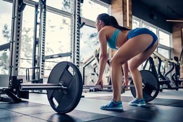 Sports woman in gym Fototapete