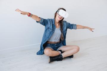 Dreaming girl using VR glasses
