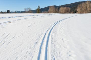Winter landscape. Winter landscape. Ski track in the snow. Natural background, pattern.