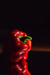 Red Paprika isolated on black