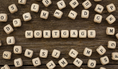Word MORTGAGE made with wood building blocks