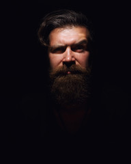 portrait of a bearded man with an evil look
