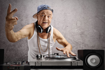 Elderly DJ making a peace sign