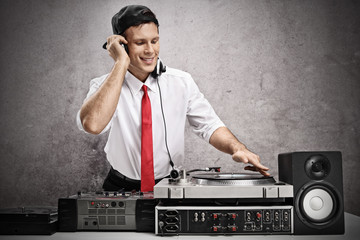 Formally dressed man playing music on a turntable